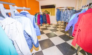 Recently donated coats line the Coats 4 Kids display room at the Bonner Mall in Ponderay, which will be the location of the KXLY weather broadcast and distribution day on Oct. 26. Photo by Cameron Barnes.