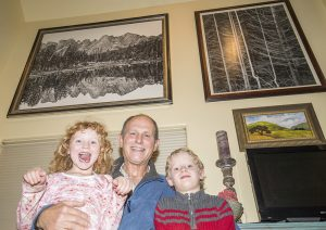 Anya, Charles and Aiden Phillips at their family home in Sagle. Photo by Cameron Barnes