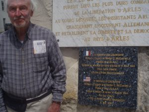 Jim Ramsey stands by the monument in Arles, France. Courtesy photo.