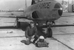 Jim Ramsey kneels before his  T-33 jet trainer in this photograph taken in 1957 at Bryan A.F.B, Texas. Courtesy photo.