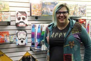 Julie Martin prepares for the grand opening of Zany Zebra on Saturday, Nov. 19. Photo by Ben Olson.