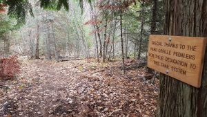 A commemorative plaque thanking POP for their trail work on Lost Lake Trail System.  Photo by Steve Sanchez.