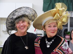 SASi volunteer Linda Melia, left and SASi board member Loris Michael, right, pose during the High Tea fundraiser last week at the Sandpoint Senior Center. Courtesy photo.