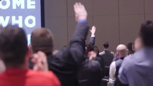 Attendants at the National Policy Institute's annual conference give Nazi salutes as NPI head Richard Spencer praises president-elect Donald Trump. YouTube screenshot.