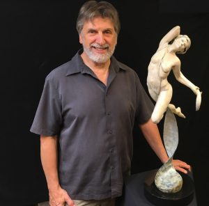 Steve Gevurtz poses with one of his creations. Photo by Kevin Penerlick.