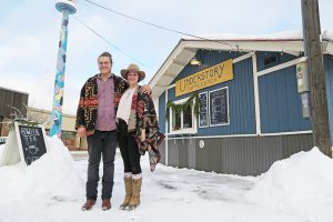 Understory Coffee co-owners Evan Metz and Johnelle Fifer stand by their newly acquired coffee hut on Second Ave. and Cedar St. Photo by Ben Olson.