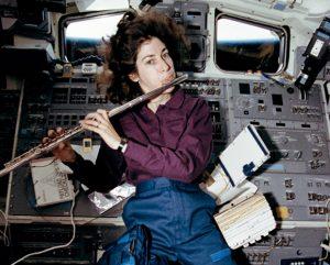 Astronaut Ellen Ochoa plays the flute in space. Photo courtesy of NASA.
