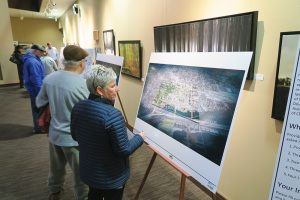 Kathy Andruzak looks at one of the display images at the first open house meeting last month. Photo by Ben Olson.