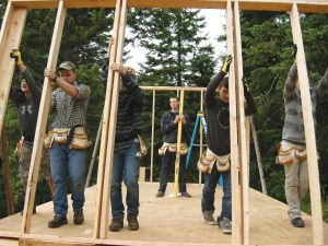 The Eureka Center program participants erect one of the shelters that will be placed at bus stops. Courtesy photo.