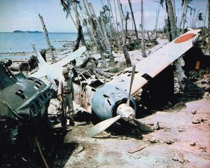 A soldier stands next to a downed Mitsubishi Zero fighter on the Soloman Islands in 1943. Courtesy photo.