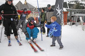 Matt Gillis, center, pounds a fist with Hank Sturgis during 24 Hours for Schweitzer 2017. Courtesy photo.