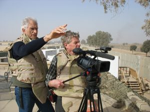 "Director Terry Sanders, left, and cameraman Erik Daarstad, right, on location in Balad, Iraq while filming ""Fighting For Life."" Courtesy image."