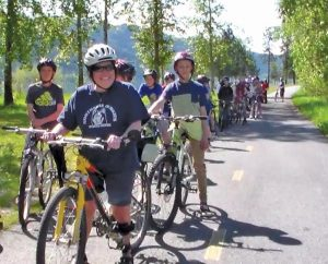 Top: Jayne Sturm enjoying a bicycle ride with her students. Courtesy photo.